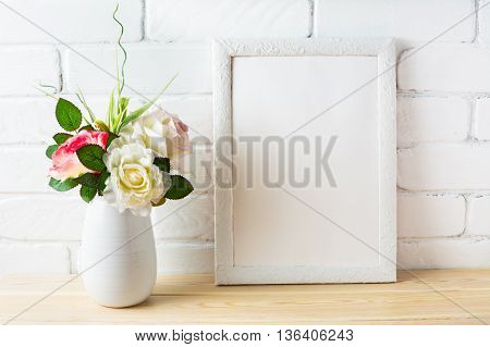 Shabby chic style white frame mockup with pink roses. Empty white frame mockup for design presentation. Portrait or poster white frame mockup.