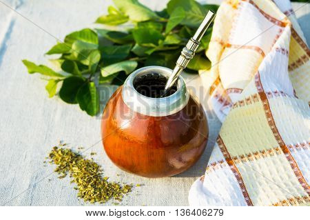 Yerba mate in gourd calabash with bombilla. Traditional Latin America herbal tea in mate calabash with special mate drinking straw bombilla.