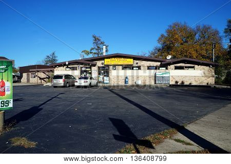 JOLIET, ILLINOIS / UNITED STATES - NOVEMBER 1, 2015: The S&T Food Mart offers hot food and groceries in Joliet.