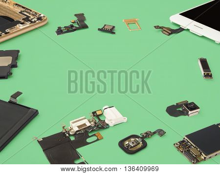 Smart phone components isolate on green background with copy space
