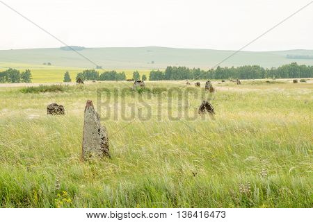 Ancient gravestone in the steppe of southern Siberia.