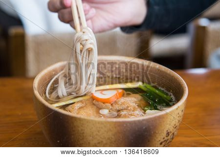 Close up ramen noodle on wooden table