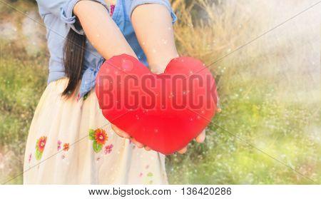 Women Hold Big Red Heart In Glitter Bokeh Shining
