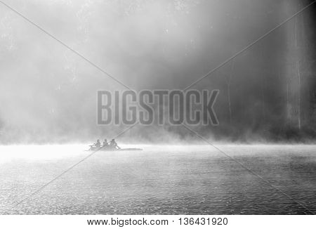Rowboat on the lake at morning fog at Mae Hong Son or Pang Ung. black and white picture