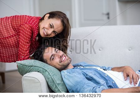 Portrait of happy romantic couple relaxing on sofa at home