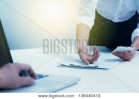 Business People Meeting To Discuss The Situation On The Market, Some Businessman Put Hand On Laptop,