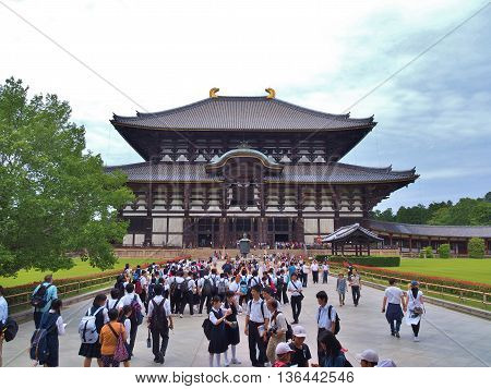 NARA, JAPAN - JUNE 6, 2016: Unidentified people in front of Great Buddha Hall at Todai-ji temple. The temple is a listed UNESCO World Heritage Site as one of the