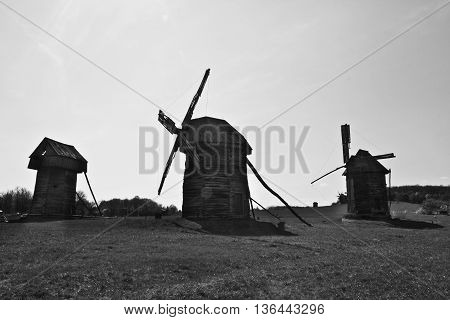 Landscape with old windmills in the village Pirogovo, Ukraine Eastern Europe. Black and white image.