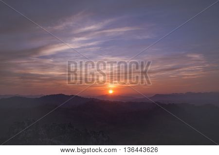 Colorful sunset on top of thailand mountain