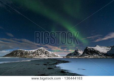 Aurora borealis over Skagsanden beach on Lofoten Islands Norway March 2016