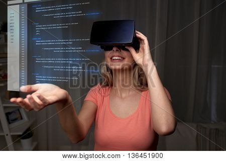 technology, virtual reality, cyberspace, entertainment and people concept - happy young woman with virtual reality headset or 3d glasses at home looking at coding projection poster