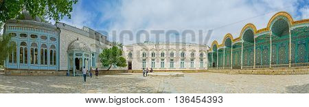 BUKHARA UZBEKISTAN - APRIL 29 2015: The panorama of the white Sitorai Mokhi-Khosa Palace and its bright blue summer gallery covered with the complex islamic patterns on April 29 in Bukhara.