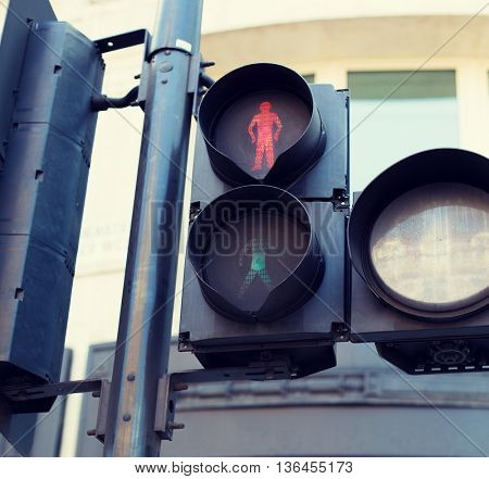 highway code, traffic and city life concept - red pedestrian traffic lights