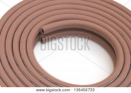 Roll of brown multipurpose sticking bumper over white background