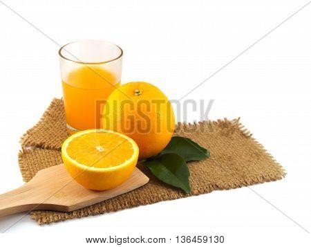 Orange fruit and orange juice on gunny of isolated