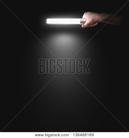 Hand holding lamp near the wall, isolated. Idea, logo, poster design presentation in spotlight. Wall mockup in light. Person hold torch in hands. Handle lantern. Illuminate the wall. Man illiminating. poster