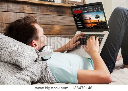 Man watching tv series on a laptop, while lying on the bed. View of laptop screen with streaming service template design.