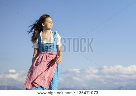An image of a young woman in bavarian traditional dress dirndl