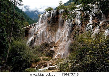Jiu Zhai Gou, Sichuan China: August 23, 2006: Pearl Shoal Waterfall at Jiu Zhai Gou National Scenic Park