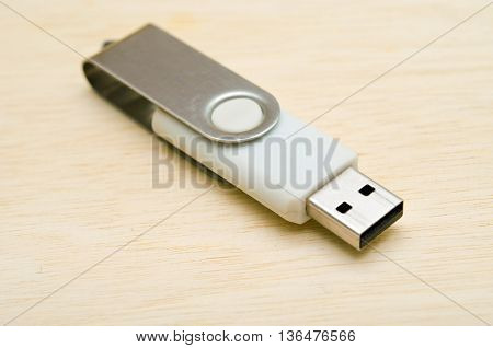 USB stick or USB thumb drive isolated on wooden board background
