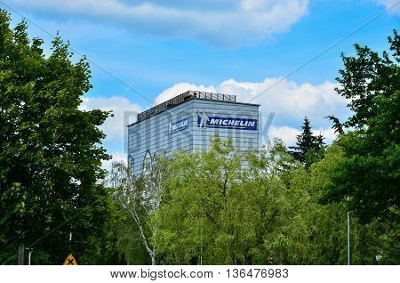 14 June 2016 Olsztyn-Poland, Michelin logo sign on blue sky background. Bibendum commonly referred to as the Michelin Man is the symbol of the Michelin tyre company. Michelin is one of the two largest tyre manufacturers in the world along with Bridgestone