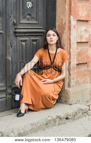 Beautiful boho style girl in a long dress, street fashion