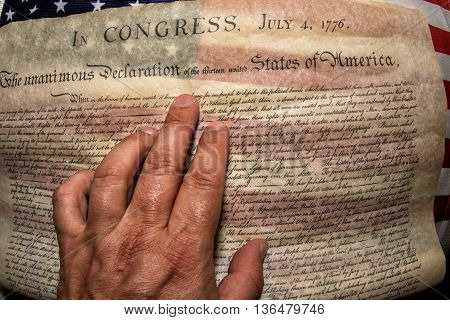 Hand On Declaration Of Independence 4Th July 1776 On Usa Flag