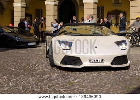 Sant'Agata Bolognese, Italy - April 30, 2016: Lamborghini parade in front of the municipality of Sant'Agata Bolognese for the 100th Ferruccio Lamborghini Anniversary