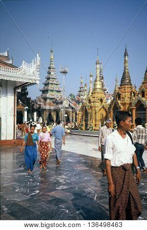 RANGOON / MYANMAR - CIRCA 1987: Worshipers visit the Shwedagon Pagoda in Rangoon.
