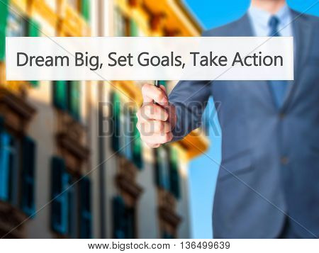 Dream Big Set Goals Take Action - Businessman Hand Holding Sign