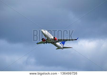 ST PETERSBURG RUSSIA-MAY 112016.LN-RNU SAS Scandinavian Airlines System Boeing 737 Next Gen airplane is flying after departure.