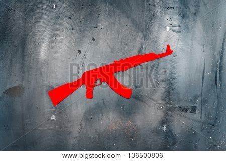AK 47. Kalashnikov automatic rifle. Paper, red, on metal grunge background. Copy space.