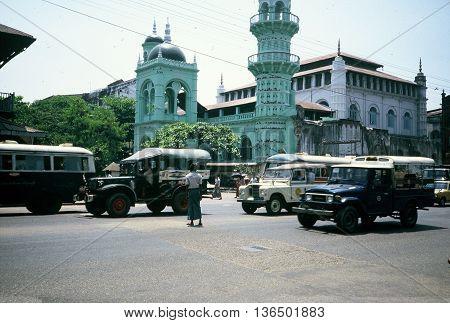 RANGOON / MYANMAR - CIRCA 1987: Traffice circulates in front of the Surti Sunni Jamah Mosque in Rangoon.