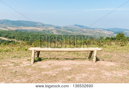 Lonely bamboo bench for relaxing on the top of high mountain.