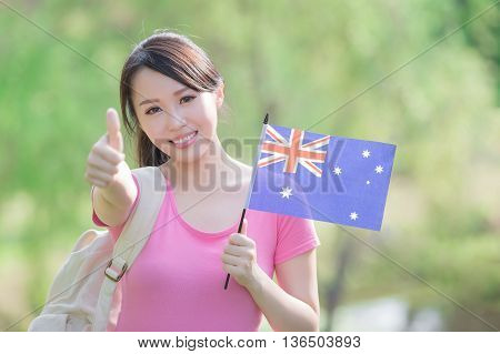 Happy College Student girl hold australian flag and show thumb up with nature white background asian