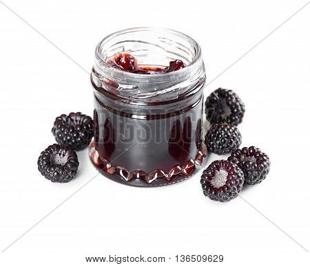 Jam made from black raspberries Cumberland in glass jar isolated on white background