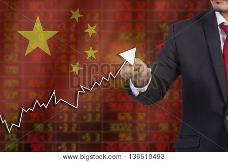 Flag Of China. Downtrend Stock Data Diagram With Business Man Pushing On A Touch Screen Interface An