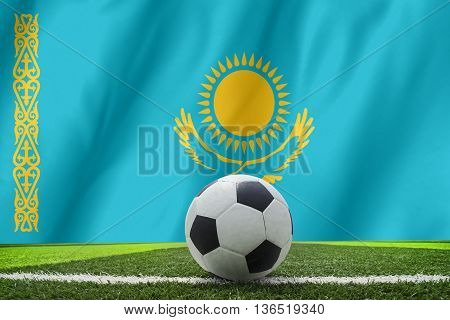 Soccer Ball And National Flag Of Kazakhstan Lies On The Green Grass