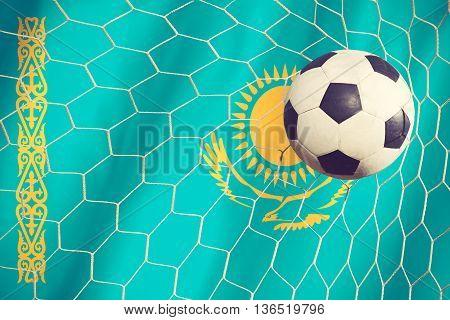 Kazakhstan Flag And Soccer Ball, Football In Goal Net Vintage Color