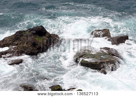 Rocks in the surge off the Atlantic island of Madeira