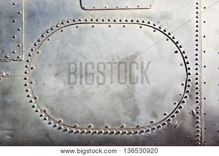 Old metal background with plate and rivets