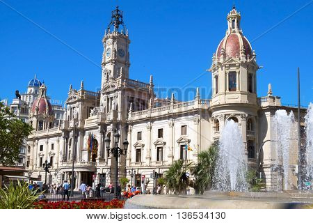 VALENCIA, SPAIN - JUNE 21: View of Ayuntamiento de Valencia, the City Hall, on June 21, 2016 in Valencia, Spain. This neoclassical and baroque building gives name to the square, Plaza del Ayuntamiento
