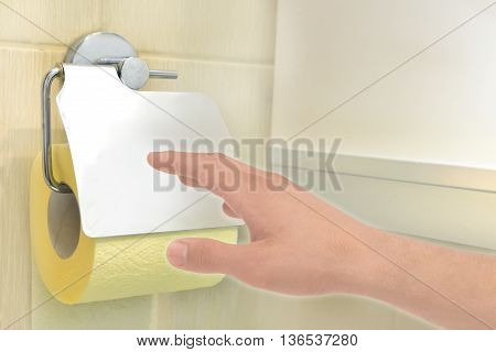 Hand in toilet reaches for toilet paper (facial tissues)