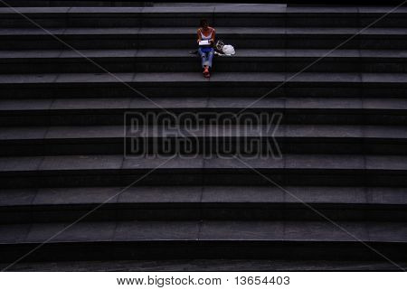 Lady readin a book on steps in London