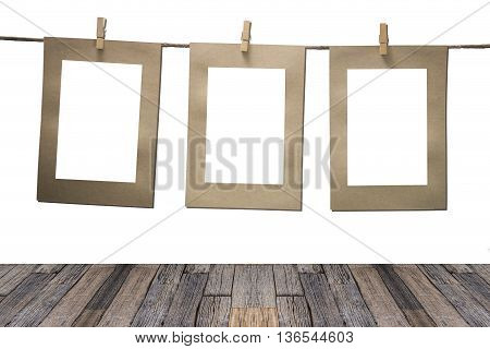 blank instant photos hanging on the clothesline. Isolated on white background.