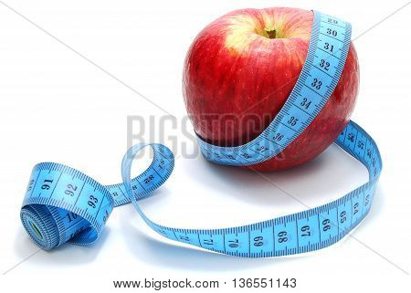 Red Apple with Measure Tape on White Background