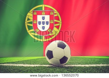 soccer ball in front of the Portugal flag vintage color