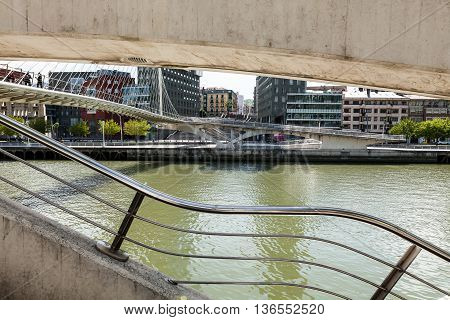 Bilbao, Vizcaya/Spain - 06/16/2016: Perspective Calatrava or Zubizuri Bridge on the River Nervion in Bilbao
