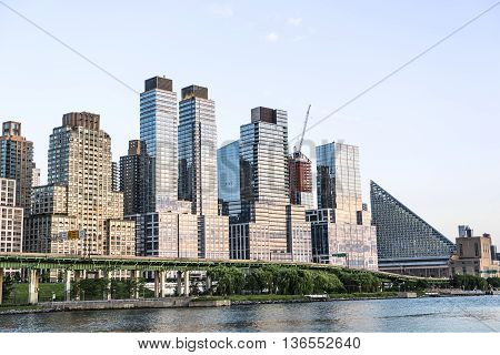 New York, USA - June 18, 2016: Skyline of Trump skyscrapers and FDR highway in Riverfront park in New York City