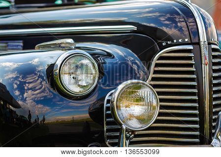MINSK BELARUS - MAY 07 2016: Close-up photo of black Buick Eight 1940 model year. Fragment of old vintage car. Headlights of retro auto. Selective focus.